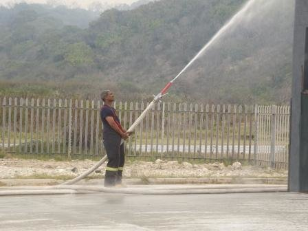 Fire Fighter dousing our thatch roof - just in case.